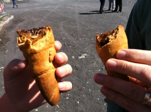 A cone shaped cookie filled with dulce de leche