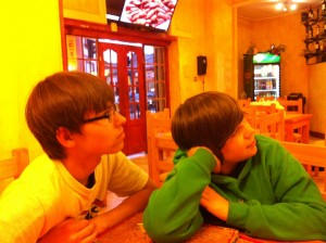 Timothy and Andrew watching this man at the restaurant.
